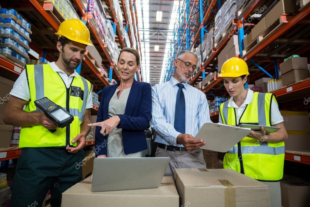 depositphotos_115155032-stock-photo-businessmen-and-warehouse-workers.jpg